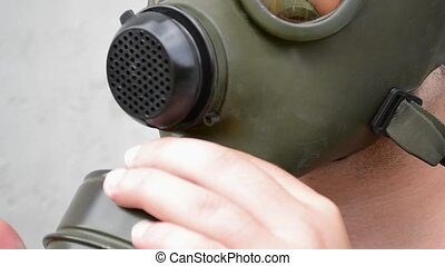 Man Mount Air Filter on Gas Mask - Man mounts the air filter...