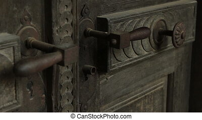 Locked Rusty Door - A man clicks the iron handle of a old...
