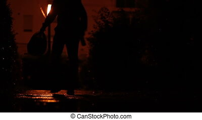 Man Carrying Bag in the Dark - Silhouette of a man with...