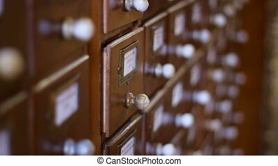 Look Up Library Cards Database - A hand open the wooden...