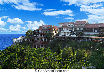 houses on a hill by the sea