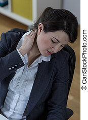 Long time at work - Woman with neck pain after long time at...