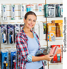 Customer Holding Packed Product In Hardware Store