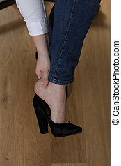 Aching feet - Close-up of young woman's aching feet in high...