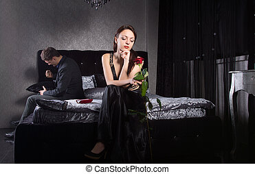 Young Couple Quarreling While at the Bedroom - Young Couple...