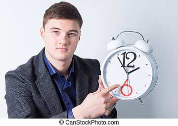 Handsome Businessman Advertising Alarm Clock - Close up...