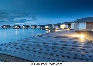 relax on water bungalow - group of water bungalow short...