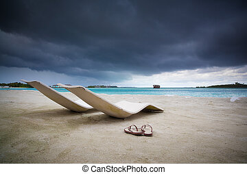 Before the tropical storm - relax on beach before storm,...