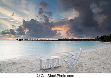 relax on beach - sunrise on tropical beach, malediven