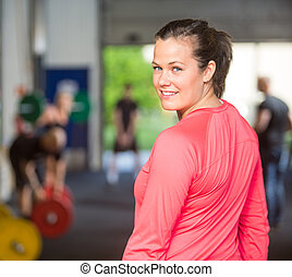 Portrait Of Fit Woman At Healthclub - Rear view portrait of...