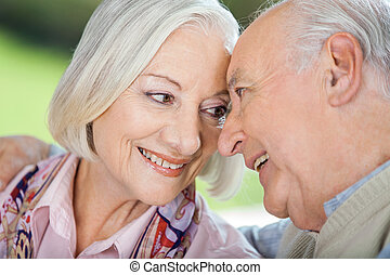 Loving Senior Couple Looking At Each Other