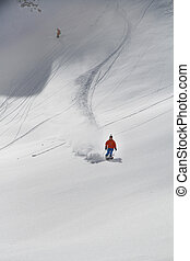 Skier in deep powder, extreme freeride in the mountains