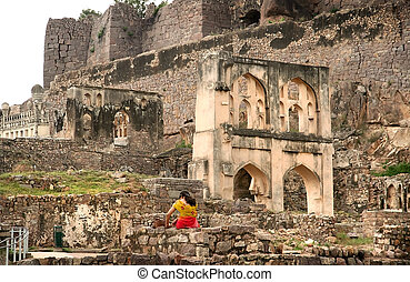 Golkonda Fort - Lonely girl waiting at historic Golkonda...