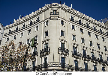 facades of typical architecture of the capital of Spain,...