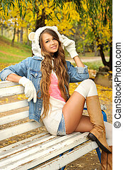 Happy young woman dressed in a white bear hat - Happy young...