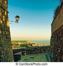 Castiglione della Pescaia, lamp and terrace sunset view on the s