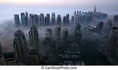 skyscraper foggy weather Dubai Marina - aerial view...
