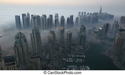 skyscraper foggy weather Dubai Marina - time lapse aerial...