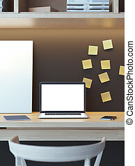Modern workspace with laptop and yellow stickers