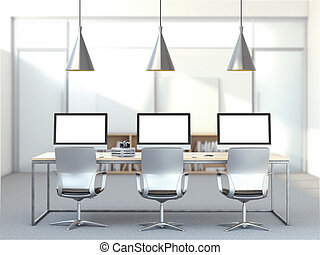 Workplace with three computers in modern studio