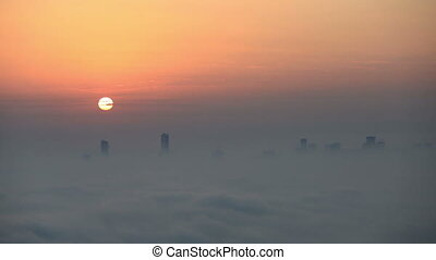 foggy weather Dubai Marina - time lapse sunrise aerial view...