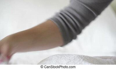 Nail Polish Remover - Woman with painted nails uses nail...
