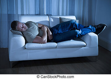 Man asleep couch images and stock photos 267 man asleep for Couch you can sleep on