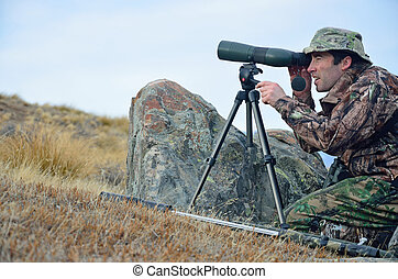 Hunter scoping for animals - Hunter scoping for Himalayan...