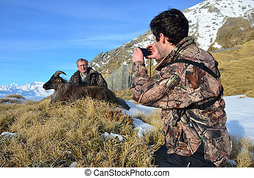 trophy tahr - A friend photographs a succesful hunter with...