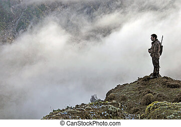 scoping for game - Hunter scoping for Himalayan tahr in the...