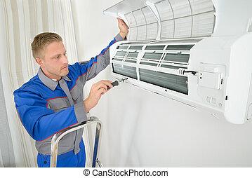 Repairer Repairing Air Conditioner - Young Man Repairing Air...