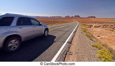 SUV car entering monument valley, utah