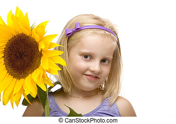 closeup of child (girl) holding a sunflower in hands on white background