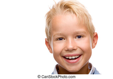 closeup of child smiling happy into camera on white...