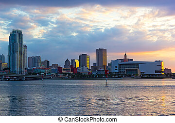 Sunset over Miami downtown, Florida. Panoramic sunset with bodies of water and city landmarks.