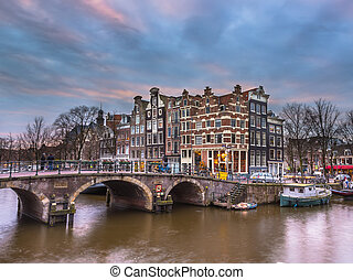 Canal houses sunset Amsterdam - Colorful traditional canal...