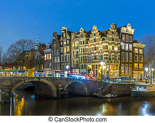 Nightscape grachtengordel Amsterdam - Night shot of Colorful...