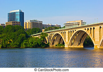 Key Bridge in Washington DC with office building on...