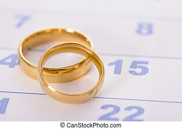 Rings On Calendar - Close-up Photo Of Golden Rings On...