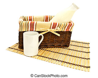 milk - bottle of milk in basket with mug near it at bamboo...