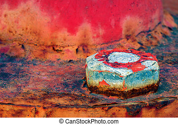 Rusty bolt - Closeup picture of a bolt on a highly textured...