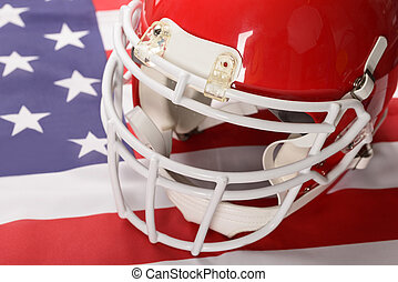 Red American Football Helmet On American Flag