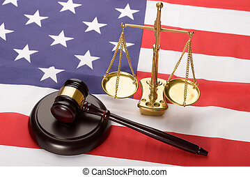Justice Scale And Wood Gavel On Usa Flag - Justice Scale And...