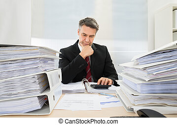 Businessman Working At Office - Photo Of Mature Businessman...