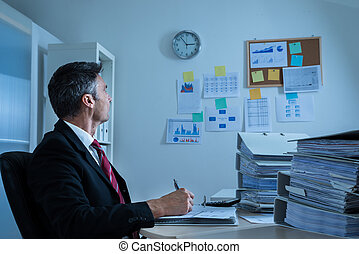 Businessman Looking At Clock - Mature Businessman At Office...