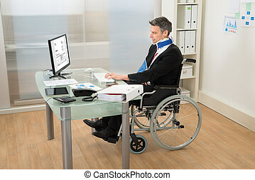 Disabled Businessman Using Computer - Disabled Businessman...