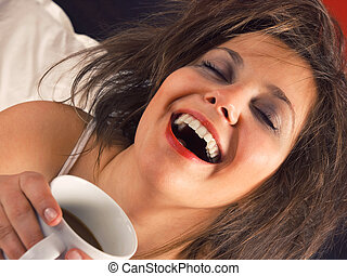Woman in bed with coffee