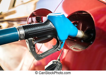 Car With A Gas Pump - Red Car At Gas Station Being Filled...