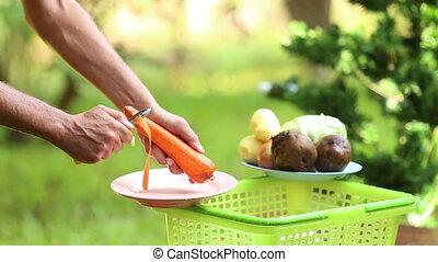 cooking ukrainian national soup borsch - man hands clean...