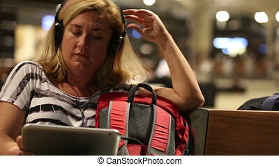 passenger waiting in airport - middle age blonde women...